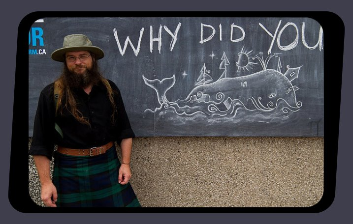 Artist David King outside whale island chalk drawing Halifax Nova Scotia